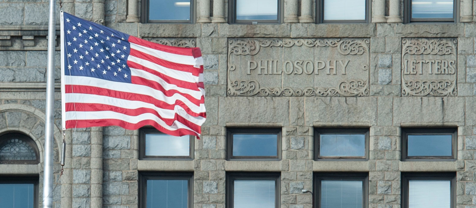 Flag waving in front of McMahon Hall on campus